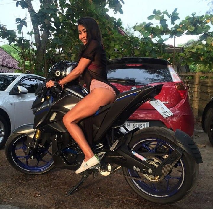 Hot Thai babe on motorbike